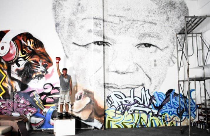 Nelson-Mandela-Portrait-made-from-27-000-Punches5-715x465